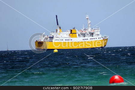 Passenger ferry at sea stock photo, Side view of passenger ferry sailing in blue sea. by Martin Crowdy