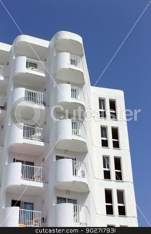 White tourist hotel stock photo, White tourist hotel with blue sky background, Majorca, Spain. by Martin Crowdy