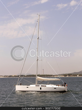 Yacht sailing in ocean stock photo, Side view of white yacht sailing on ocean. by Martin Crowdy