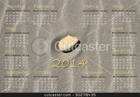 2014 english calendar with stone on sand