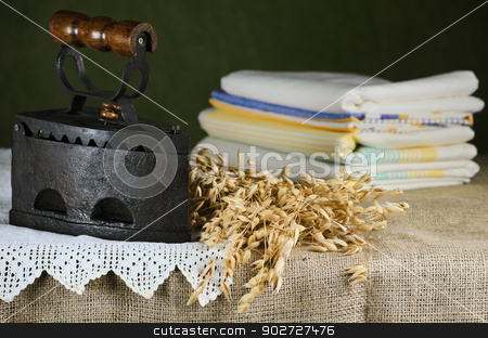 Old Iron stock photo, Old Iron And Bunch Of Oats On The Table by Sergej Razvodovskij