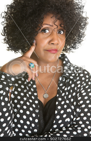 Skeptical Woman stock photo, Skeptical lady in polka dot over white background by Scott Griessel