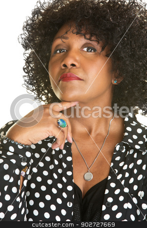 Lady Holding Chin stock photo, Pretty woman in polka dot holding chin with finger by Scott Griessel