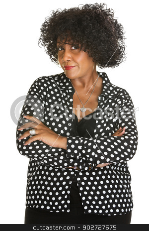 Woman with Folded Arms stock photo, Woman in polka dot with folded arms over white background by Scott Griessel