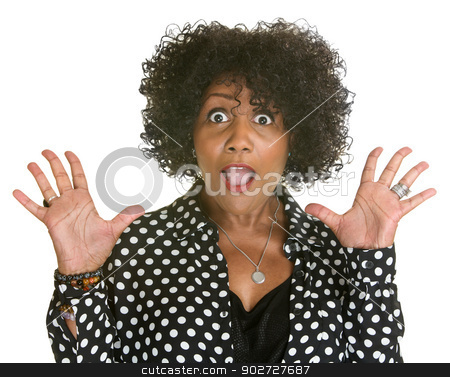 Mature Woman in Polka Dot stock photo, Surprised mature Black woman with hands up by Scott Griessel