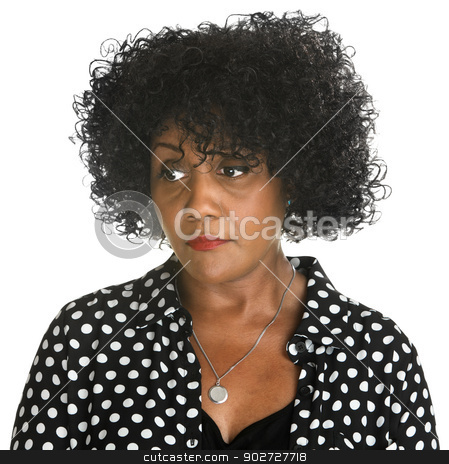 Serious Woman Looking Over stock photo, Serious African woman in polka dots looking over by Scott Griessel