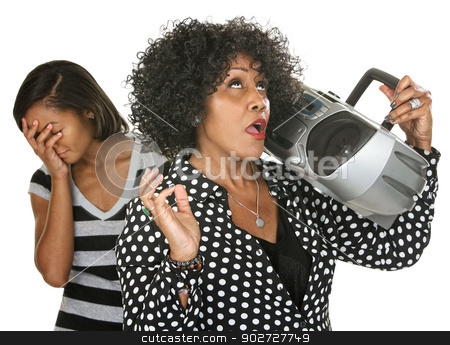 Funny Parent Singing stock photo, Teen with hand on face near singing parent and radio by Scott Griessel
