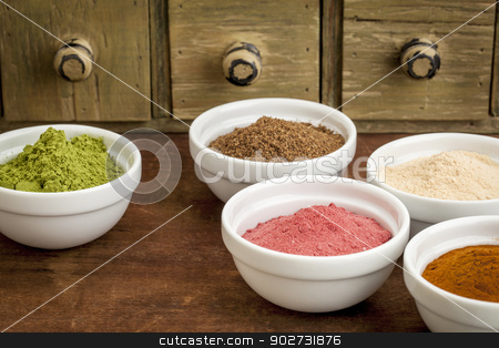 super fruit and leaf powders stock photo, super fruit and leaf powders in small ceramic bowls - baobab, noni, yumberry, moringa, mangosteen by Marek Uliasz