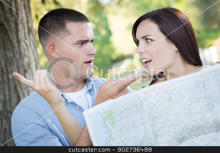 Lost and Confused Mixed Race Couple Looking Over Map Outside stock photo, Lost and Confused Mixed Race Couple Looking Over A Map Outside Together. by Andy Dean