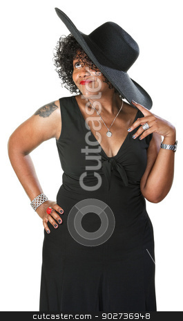 Daydreaming Mature Woman stock photo, Daydreaming mature African woman in black on isolated background by Scott Griessel