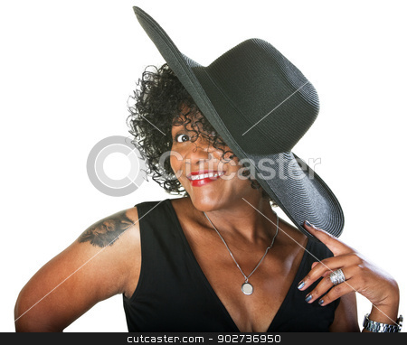 Excited Lady in Large Hat stock photo, Excited mature woman with large hat and tattoo by Scott Griessel