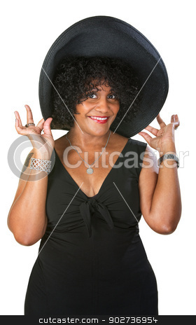 Cute Hispanic Woman stock photo, Cute flattered Hispanic woman holding oversized hat by Scott Griessel