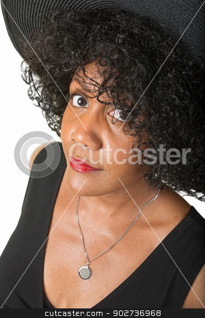Doubting Woman stock photo, Doubting Hispanic woman in hat on isolated background by Scott Griessel