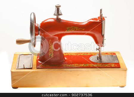 Child sewing machine stock photo, Old russian child sewing machine on a light background by Alex Varlakov