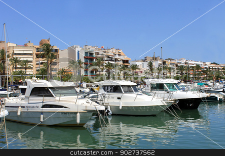 Alcudia harbor in Spain stock photo, ALCUDIA BAY, MAJORCA, SPAIN - 4th August 2013: Alcudia Bay resort and harbor on the 4th August 2013. This is a popular tourist destination every summer, particularly from visitors from European countries. by Martin Crowdy