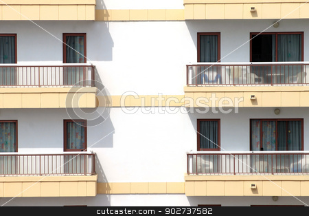 Balconies on hotel building stock photo, Closeup of hotel building with balconies and windows. by Martin Crowdy