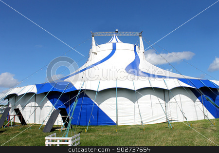 Circus tent in field stock photo, Scenic view of striped circus tent in field, summer scene. by Martin Crowdy