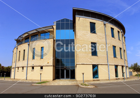 Empty modern office building stock photo, Exterior of empty modern office building with blue sky and cloudscape background. by Martin Crowdy