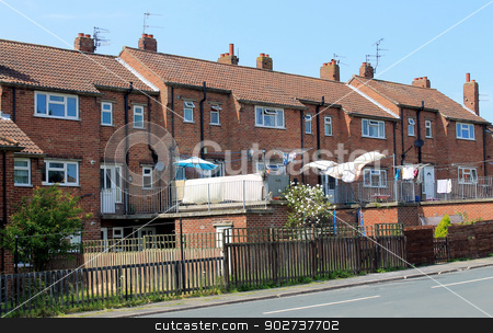 English terraced houses stock photo, Row of English terraced houses in street. by Martin Crowdy