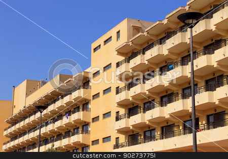 Generic tourist hotels stock photo, Exterior of old generic tourist hotels with blue sky background. by Martin Crowdy