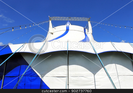 Low angle view of circus big top tent stock photo, Low angle view of circus big top tent, blue sky background. by Martin Crowdy