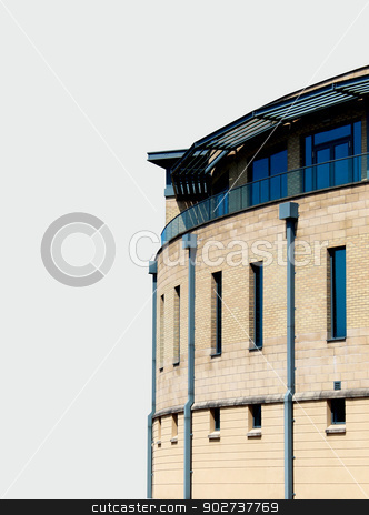 Modern office building isolated stock photo, Side view of modern office building isolated on white background with copy space. by Martin Crowdy