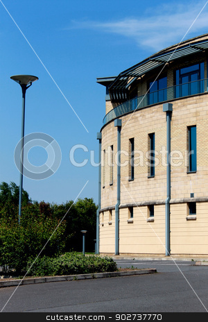 Modern office building stock photo, Side view of modern office building showing curved exterior. by Martin Crowdy