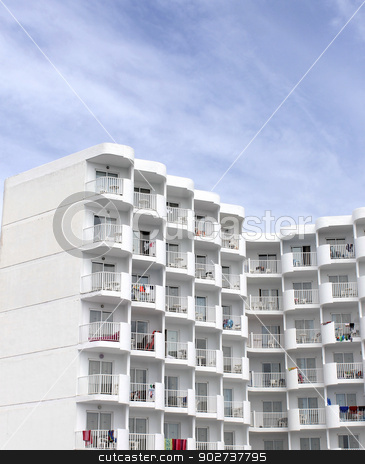Tall white tourist hotel stock photo, Tall white tourist hotel with cloudscape background. by Martin Crowdy