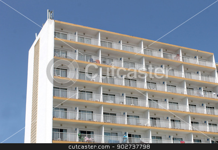 Tourist hotel stock photo, Exterior of tall tourist hotel with blue sky background. by Martin Crowdy