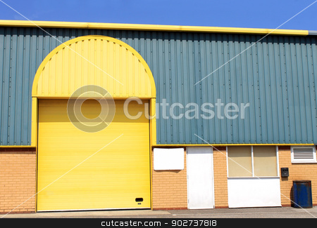 Yellow warehouse building stock photo, Exterior of modern yellow warehouse building. by Martin Crowdy