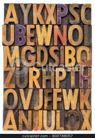 wood type alphabet stock photo, random letters of alphabet - vintage letterpress wood type printing blocks scratched and stained by color inks by Marek Uliasz