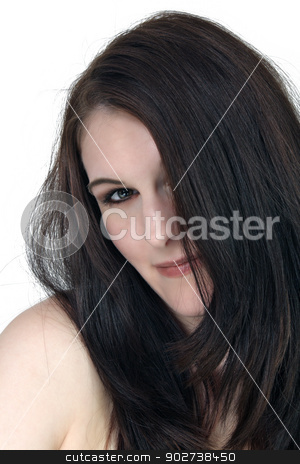 Beautiful, Shy Brunette stock photo, A close-up of a lovely shy or bashful brunette, isolated on a white background. by Carl Stewart