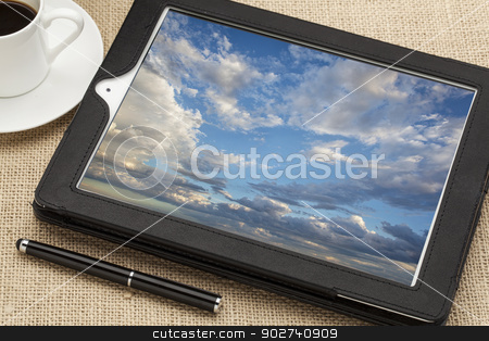 cloud computing concept stock photo, cloud computing concept - a stormy cloudscape on digital tablet computer together with a cup of coffee and stylus pen by Marek Uliasz