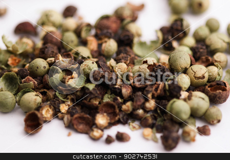 Pepper stock photo, Close-up of green brown black pepper corns on white background. by Henrik Lehnerer