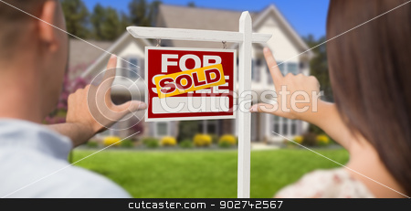 Sold For Sale Sign, House and Military Couple Framing Hands stock photo, Sold For Sale Real Estate Sign, House and Military Couple Framing Hands in Front. by Andy Dean