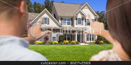 House and Military Couple Framing Hands in Front stock photo, House and Military Couple Framing Hands in Front Yard. by Andy Dean