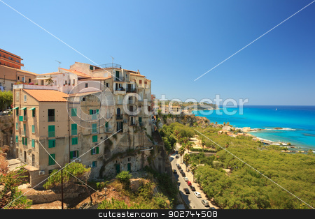 Architecture in Tropea stock photo, Tropean architecture in rustic fortress style against beautiful azure sea by Natalia Macheda