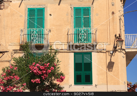 Architecture in Tropea stock photo, Typical architecture with green shutters and exotic flora of calabrian Tropea by Natalia Macheda