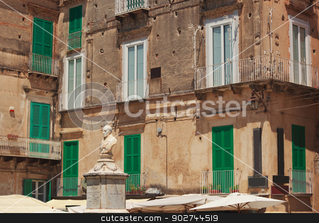 Monumento of Pasquale Galluppi in Tropea stock photo, Monumento of italian philosopher Pasquale Galluppi against Tropean-style houses with typical green shutters by Natalia Macheda