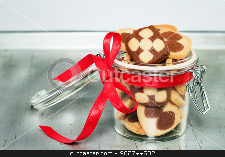 a jar filled with christmas cookies stock photo, a jar filled with christmas cookies on a silver metal tray by Rob Stark