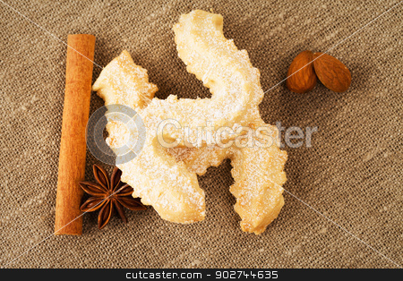 butter cookies with anise and cinnamon stock photo, butter cookies with anise, cinnamon sticks and almonds from top on a fabric by Rob Stark