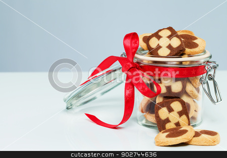 christmas cookies in a glass jar stock photo, christmas cookies in a glass jar with cookies aside with blueish background by Rob Stark