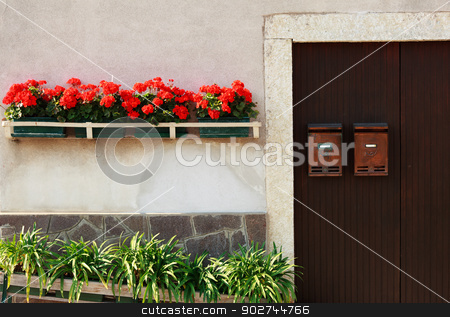 Italian style stock photo, Door with with mailboxes and floral decoration by Natalia Macheda