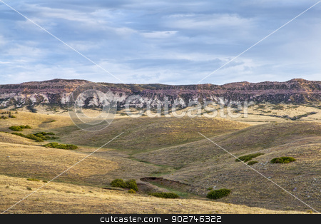 rolling prairie and cliff stock photo, rolling prairie and cliff illuminated by sunrise at Soapstone Prairie Natural Area in northern Colorado near Fort Collins, late summer by Marek Uliasz