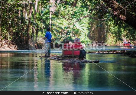 River Boat Tourists in Jamaica stock photo, Two tourists with bamboo boat captain on river in Jamaica by Scott Griessel