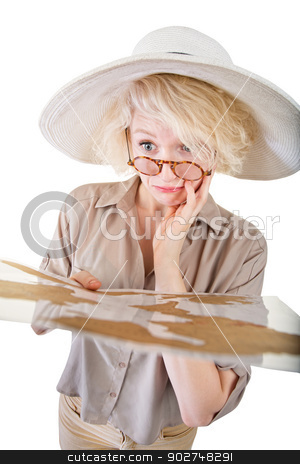 Confused Blond Woman with Map stock photo, Confused blond woman in safari clothes with map by Scott Griessel