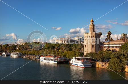 Torre del Oro Old Moorish Watchtower River Guadalquivr Seville A stock photo, Torre del Oro Old Moorish Military Watchtower River Guadalquivr Tour Boats Seville Andalusia Spain.  Built in the 1200s,  One of the oldest buildings in Seville.  Prison in the Middle Ages. by William Perry