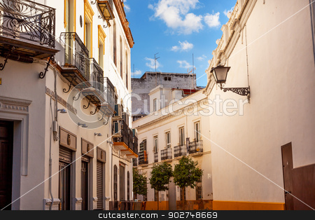 Narrow Streets of Seville Spain City View  stock photo, Narrow Streets of Seville, Street Lamp Balconies Yellow White Cityscape, City View Andalusia Spain.     by William Perry