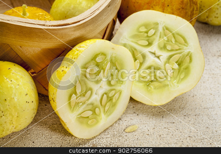 lemon cucumbers stock photo, lemon (or apple) cucumbers in a basket and on rough white painted wood surface by Marek Uliasz