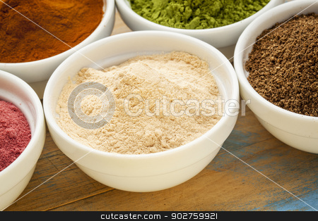 African baobab fruit  powder stock photo, African baobab fruit - organic raw dry powder in a small ceramic bowl - addition to water, smoothies and juice reach in antioxidant sand fiber by Marek Uliasz